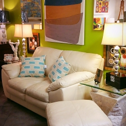 white leather love seat and ottoman
