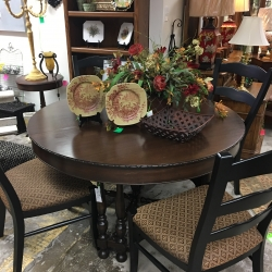 Consignment Furniture Round Table with Black Upholstered Chairs